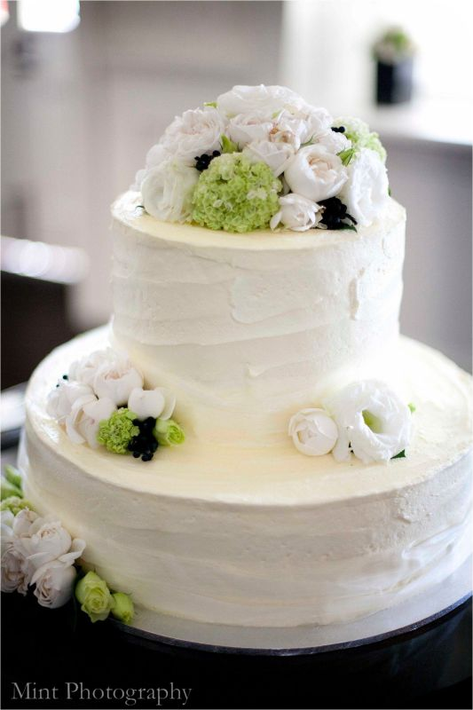 BCG45 Round 2 Tier Wedding Cake Iced In A Soft Buttercream And Decorated With Fresh White And