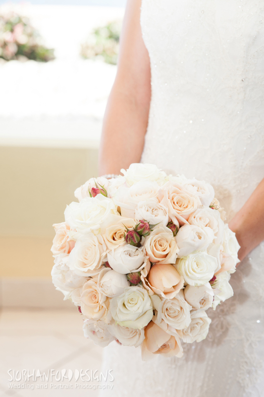 Bridal flowers gallery bg191 a clustered bouquet of sahara roses white roses and pale peach and ivory david mightylinksfo